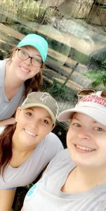 BRP Colleagues smile in front of an exhibit at the zoo in Tampa